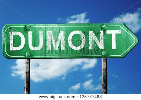 dumont road sign on a blue sky background