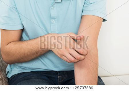 Man Suffering From Itching