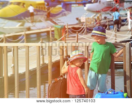 kids travel by seaplanes in Maldives, kids travel