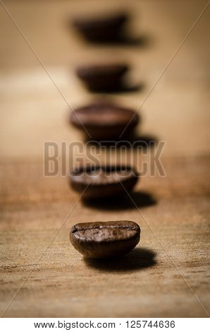 close up image of a row of coffee beans ** Note: Shallow depth of field