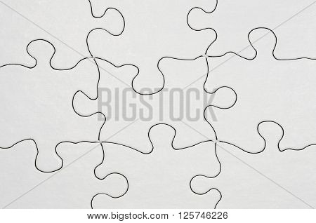 image of a blank puzzle pieces fitting together