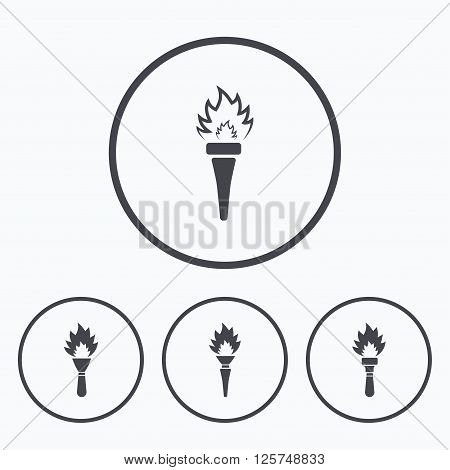 Torch flame icons. Fire flaming symbols. Hand tool which provides light or heat. Icons in circles.