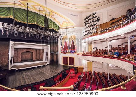 WASHINGTON - APRIL 12, 2015: Stage and seating of Ford's Theatre. The theater is infamous as the site of President Abraham Lincoln's assassination by John Wilkes Booth in 1865.