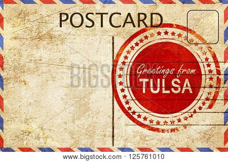 greetings from tulsa, stamped on a postcard