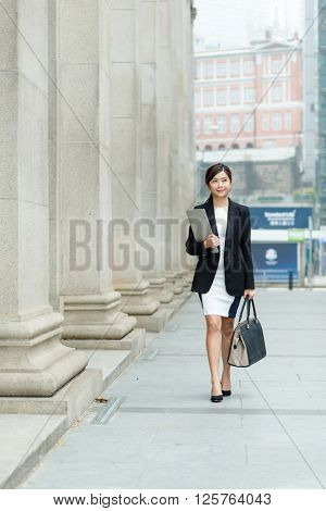 Young Businesswoman passing though the street