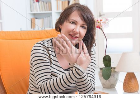 Woman doing EFT on the finger point. Emotional Freedom Techniques, tapping, a form of counseling intervention that draws on various theories of alternative medicine.