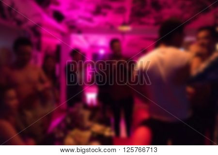 Group Of Young People Having Joyful Dancing In Nightclub Party
