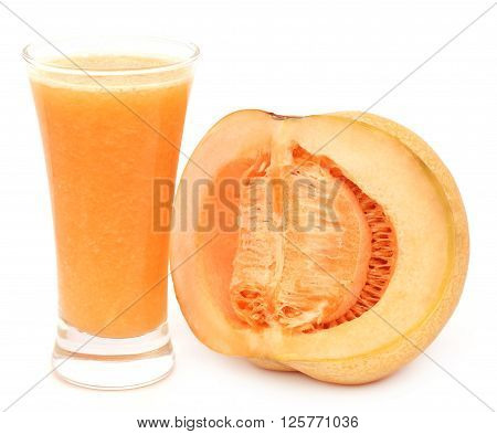 Juice of cucumis melo or muskmelon in a glass with sliced fruit