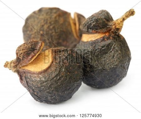 Soapnuts or Soapberries used as natural surfactant over white background