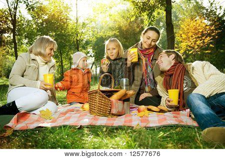 Happy Big Family in Autumn Park.Picnic.