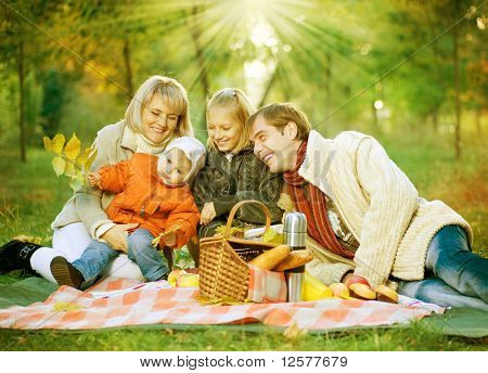 Picnic. Happy Family in Autumn Park