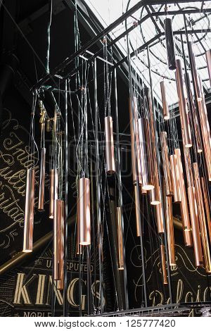 Large wind chimes with contemporary design installed in an exhibition hall.