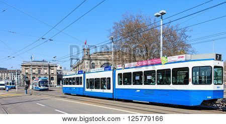 Zurich, Switzerland - 11 April, 2016: trams on the Bahnhofbruecke bridge. Trams have been a consistent part of Zurich's cityscape since the 1880s when the first horse tram ran, electrified from the 1890s.