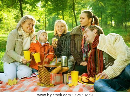 Picnic in Autumn Park.Happy Big Family outdoor