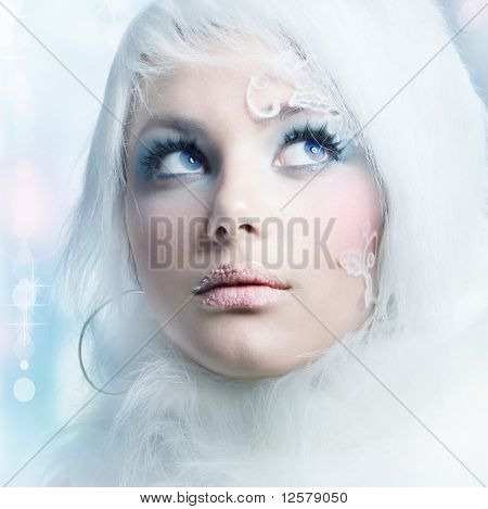 Beautiful Girl's Face.Creative Winter Makeup