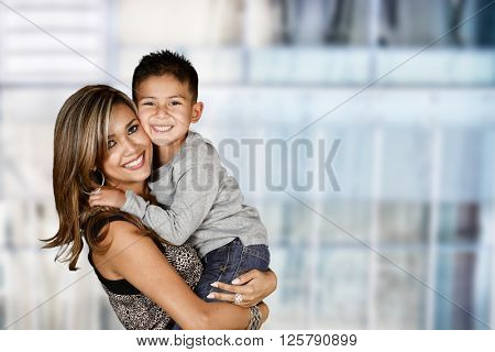 Happy young woman who is standing with her son