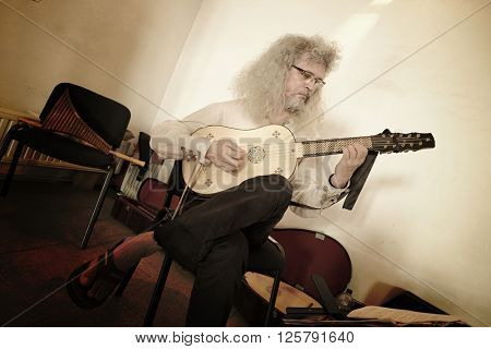 HUNEDOARA, ROMANIA - AUGUST 13, 2015: acoustic guitar player in medieval Corvin Castle of Hunedoara