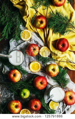 Apples on a dark wood background. Toning. Sweet apples on wooden background. Ripe red apples  on the table. Top view. Flat lay. Rustic dark food style. Red apples on wooden table