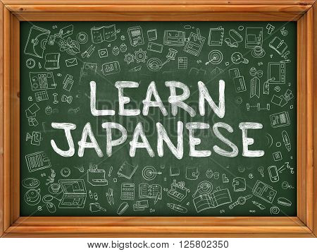 Hand Drawn Learn Japanese on Green Chalkboard. Hand Drawn Doodle Icons Around Chalkboard. Modern Illustration with Line Style.