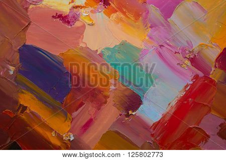 Background image of colorful oil paint palette closeup.