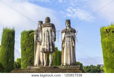 Background landscape statue Christian kings Ferdinand and Isabella and Christopher Columbus in the Alcazar, Cordoba, Spain
