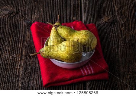 Dewy Fresh Pears In A Bowl