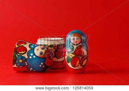 Russian traditional matreshka on plain red background