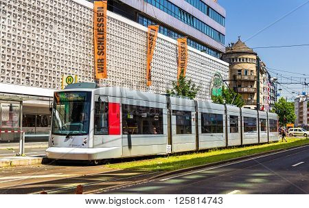 Dusseldorf, Germany - June 10, 2014: Siemens Combino tram in the city centre of Dusseldorf. The tramway network is operated by Rheinbahn AG and has 11 tram lines ran over 78 km of routes