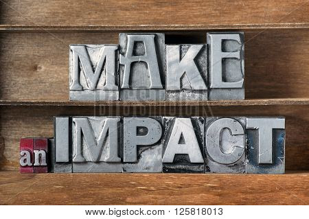 make an impact phrase made from metallic letterpress type on wooden tray