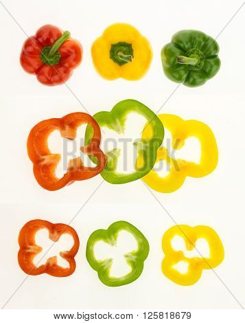 Fresh bell peppers and sliced rings isolated on white background.