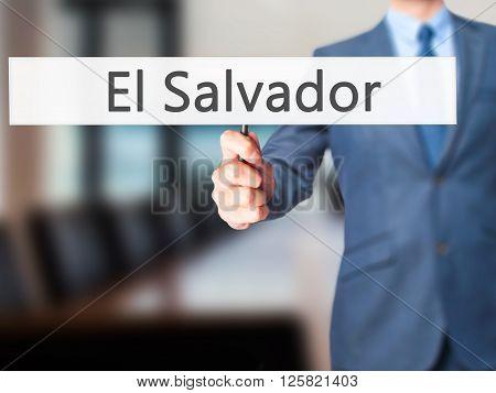 El Salvador - Businessman Hand Holding Sign