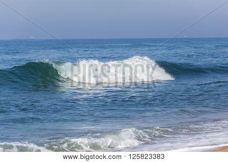 Beach ocean small wave on shoreline coastline landscape.