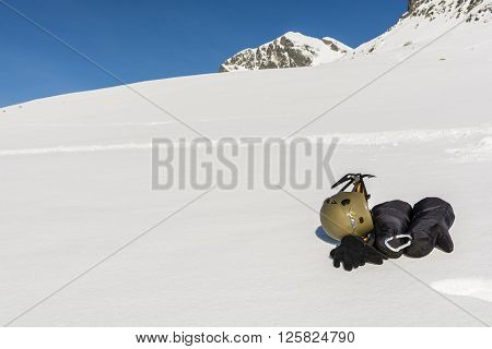 Gloves, Helmet And Ice Axe On The Slopes.