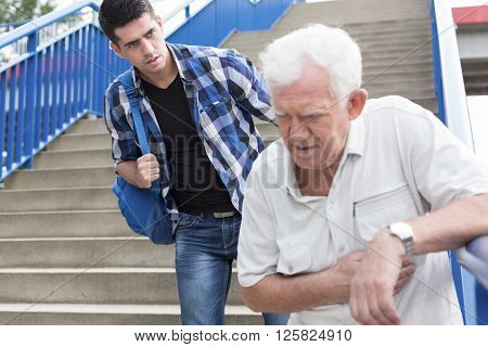 Man Giving Aid