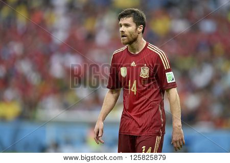 RIO DE JANEIRO BRAZIL - June 18 2014: Xabi ALONSO of Spain during the 2014 World Cup. Spain is facing Chile in the Group B at Maracana Stadium