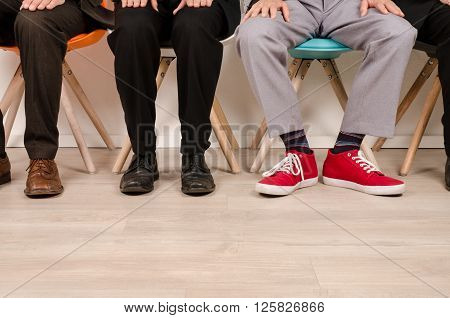 Four business men waiting for an interview