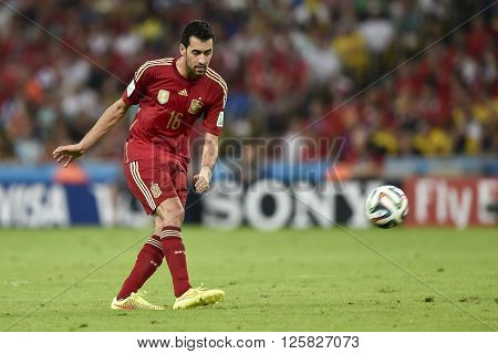 RIO DE JANEIRO BRAZIL - June 18 2014: Sergio BUSQUETS of Spain during the 2014 World Cup. Spain is facing Chile in the Group B at Maracana Stadium