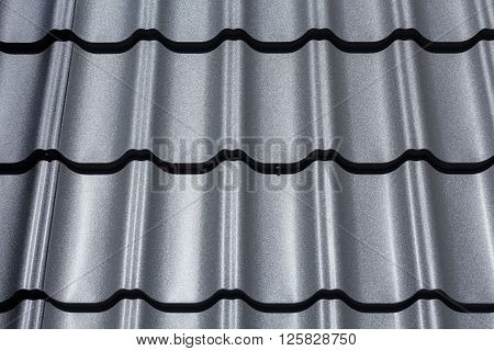Part of the roof close-up pattern of black metal tile