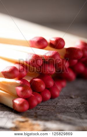 Heap Of Matchsticks With Red Heads On Wooden Board