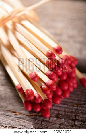 Several Matchsticks With Red Heads Bonded By Straw