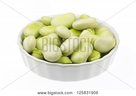 Broad beans in a ceramic pot isolated on white