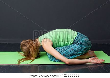 Yoga. Woman Performing A Child Pose