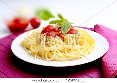 Spaghetti pasta with tomato sauce in a plate
