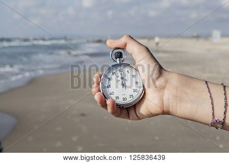 Time in My Hand Stopwatch in hand on seashore
