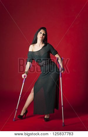 woman in an evening gown on crutches