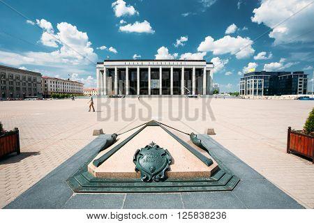 MINSK, BELARUS - June 2, 2015: Building Of The Palace Of Republic In Oktyabrskaya Square - Famous Place In Minsk, Belarus. Statue before Palace - Kilometer Zero - iconic sign, designation of zero kilometer road of Belarus