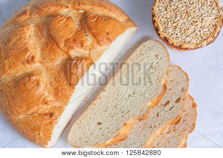 Sliced white bread and grains of wheat. Top view