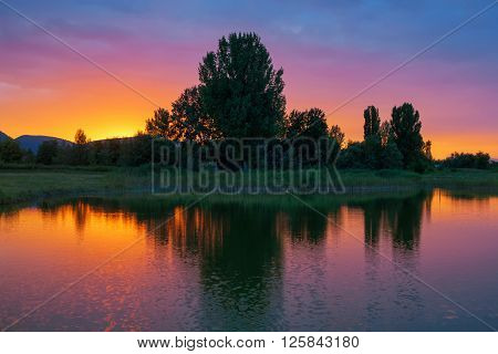 Brillant colors after sunset over a lake