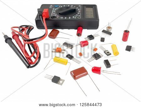 Black color digital multimeter and Radio components isolated on white background