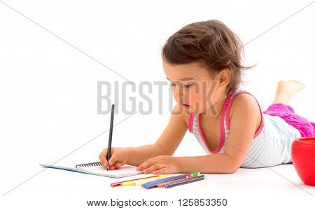 beautiful little girl drawing with multicolored pencils isolated on white
